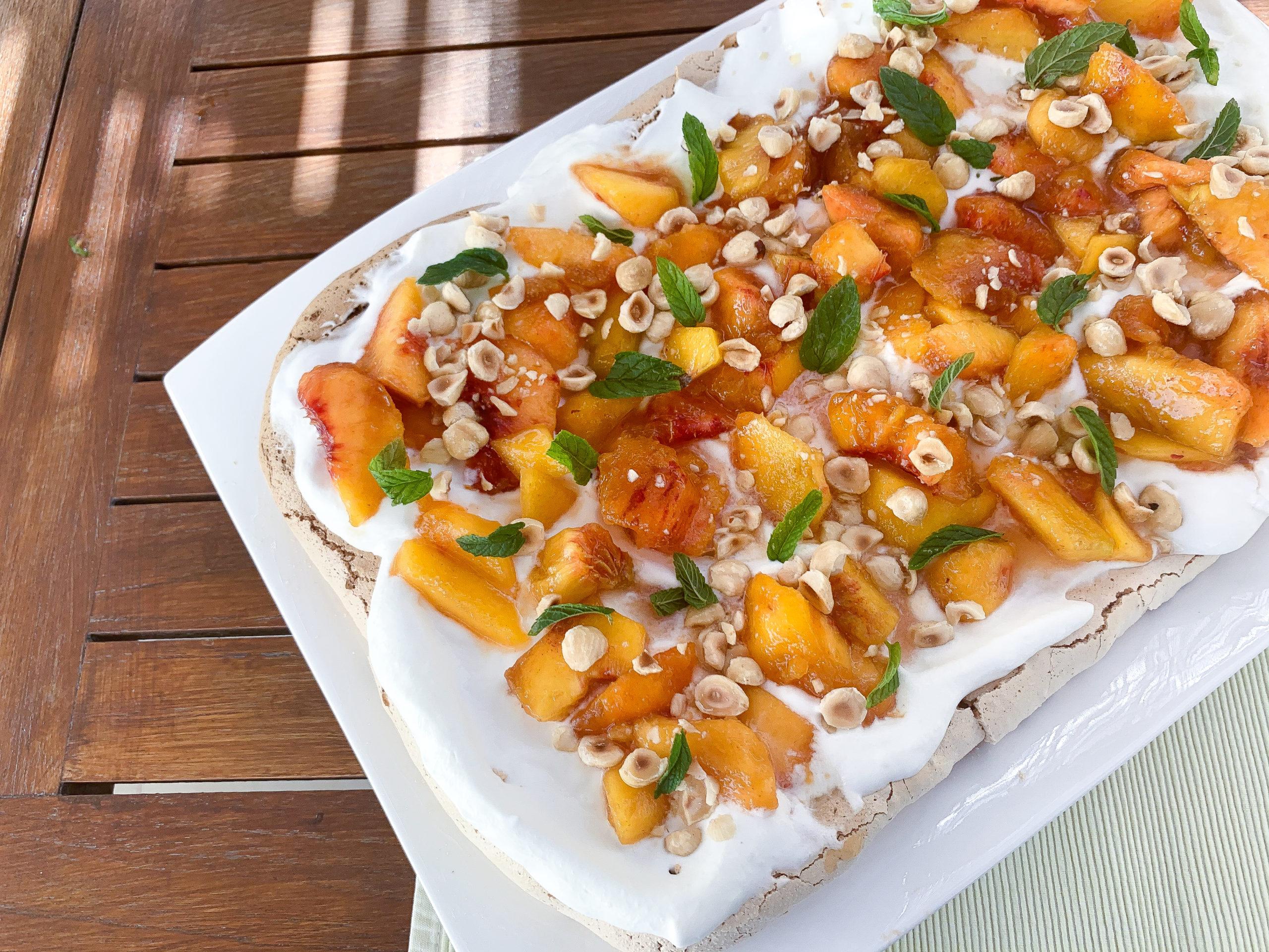 Summer pavlova with peaches and cream