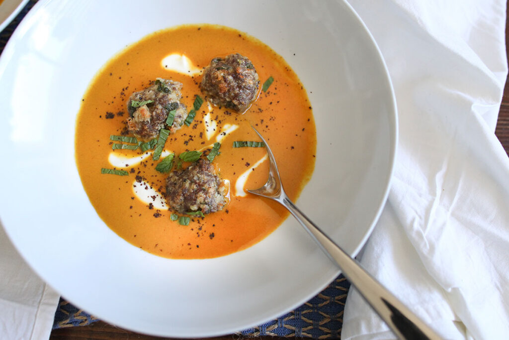 tomato and turmeric soup with lamb meatballs, yoghurt and mint
