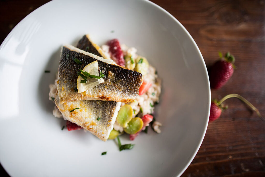 Sea bass with strawberry and broad bean risotto