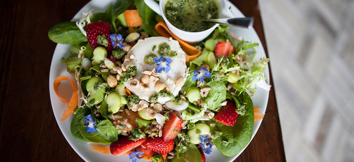 Goat cheese, strawberry and bean salad, with crushed hazelnuts and borage